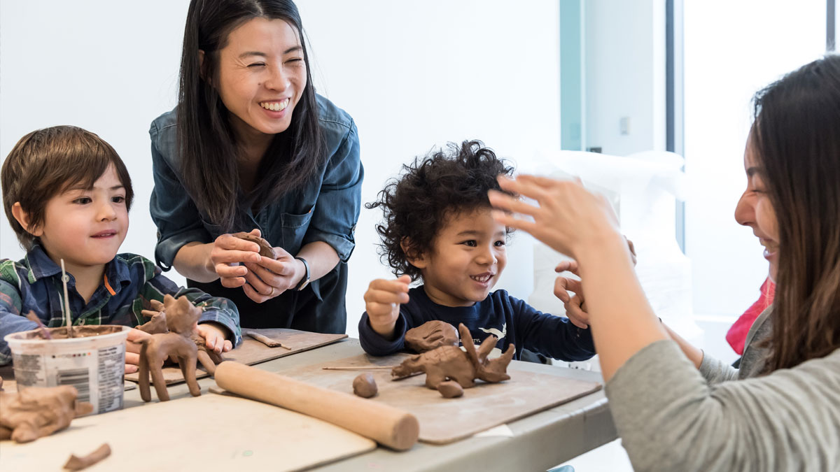 Children and adults working with clay