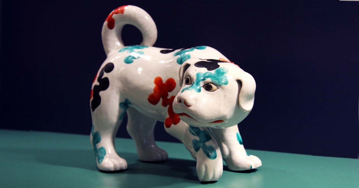 Porcelain dog with floral markings