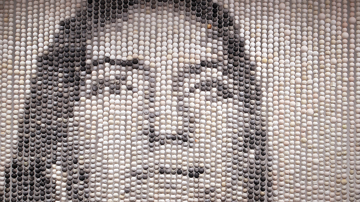 A curtain of clay beads forming a portrait of an Indigenous woman
