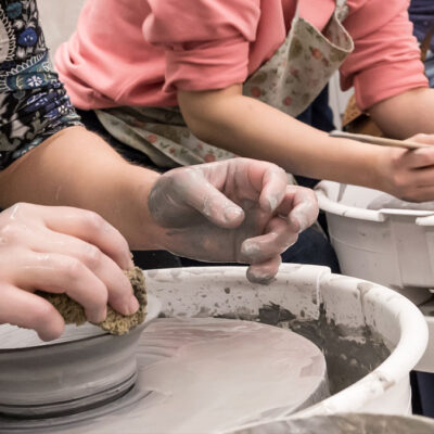 Students using the pottery wheel