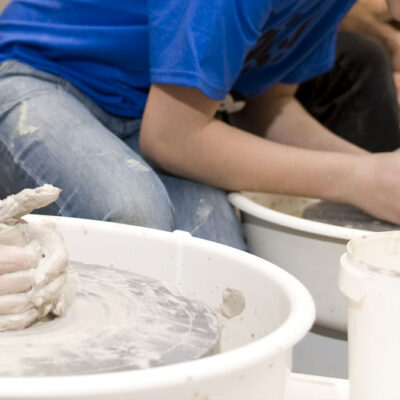 Kids using the potter's wheel