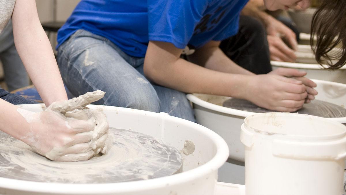 Kids using the potter's wheel