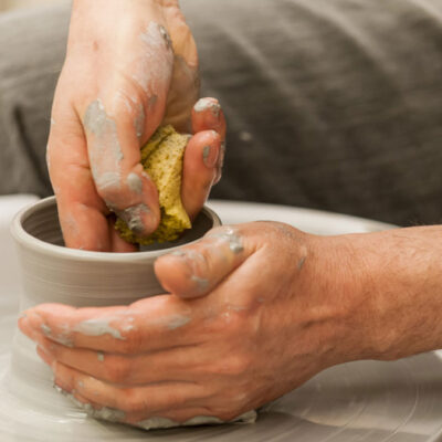 Person making a bowl on the potter's wheel