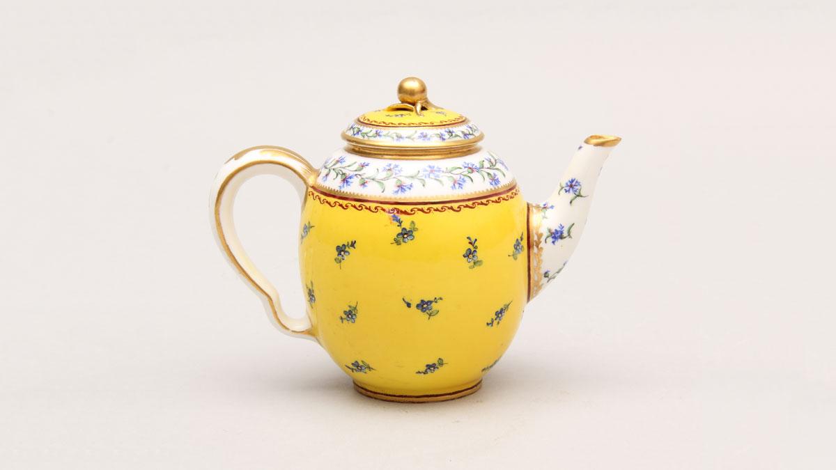 Yellow porcelain teapot