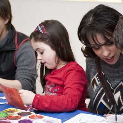 A family participating in an arts and craft activity