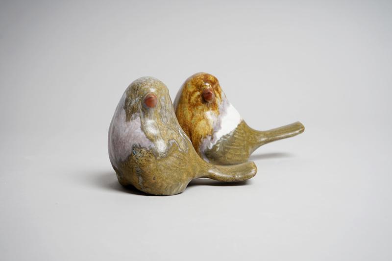 Two ceramic birds