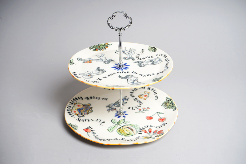 White ceramic cake stand with decoration