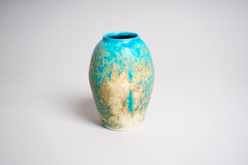 Turqouis and tan ceramic vase