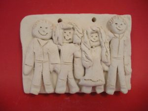 Family portrait carved in clay