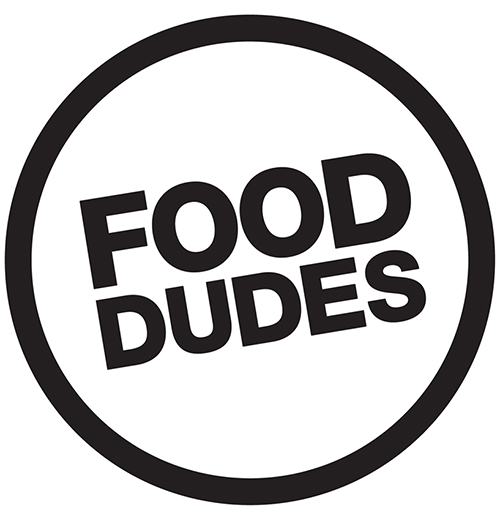 "Black circle with black writing reading ""Food Dudes"" in the centre (Food Dudes logo)"