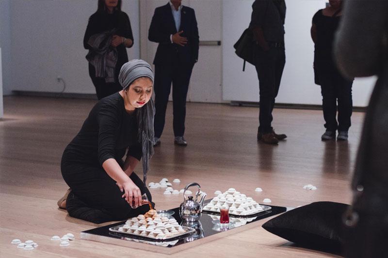 Habiba El-Sayed pouring tea over clay biscuits