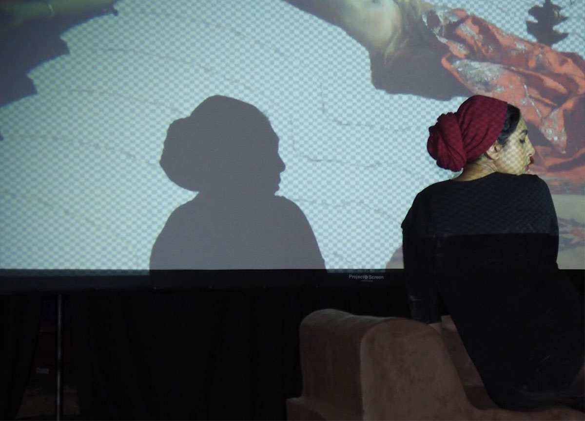 Habiba El-Sayed in silhouette in front of a screen