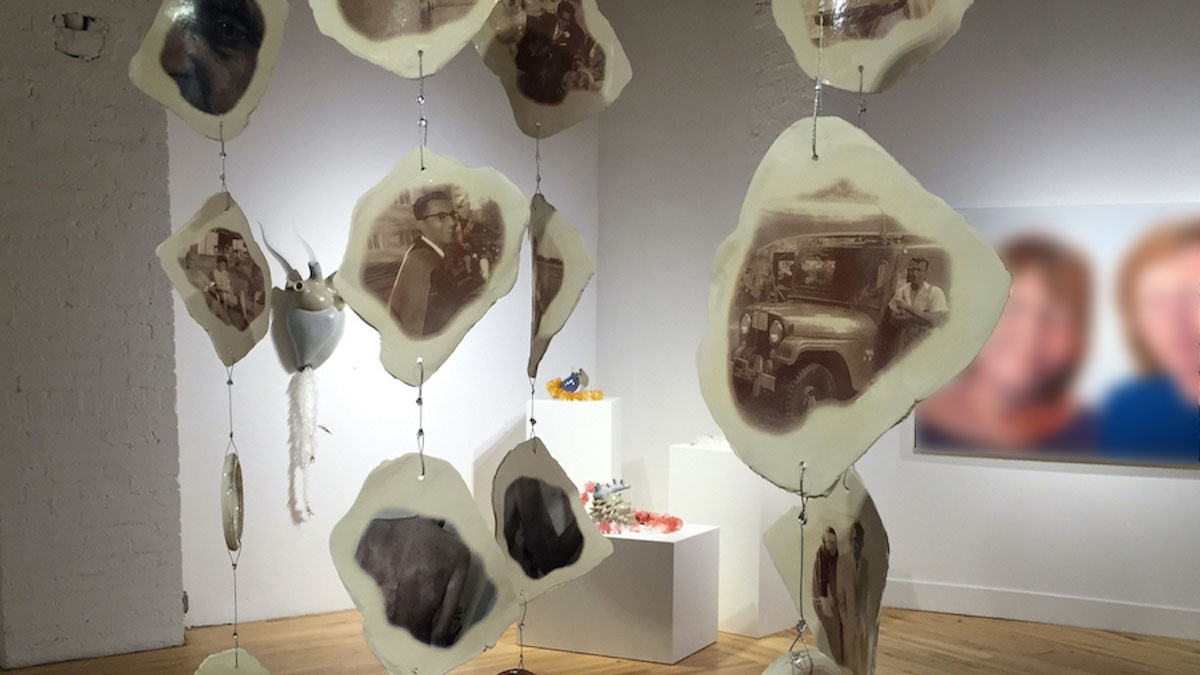 Hanging ceramic shapes with photographs