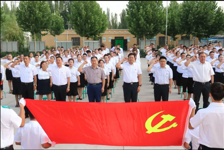 © State WeChat account | Caption: Village officials swear allegiance to the Chinese Communist Party in Kashgar, Xinjiang.