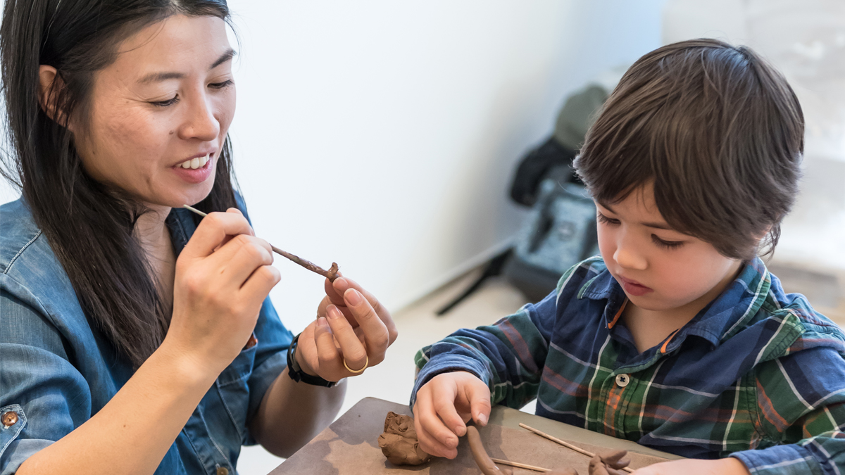 Family Day at the Gardiner Museum. A parent and child work in a clay sculpture