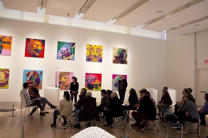 People attending a workshop in the exhibition Ai Weiwei: Unbroken