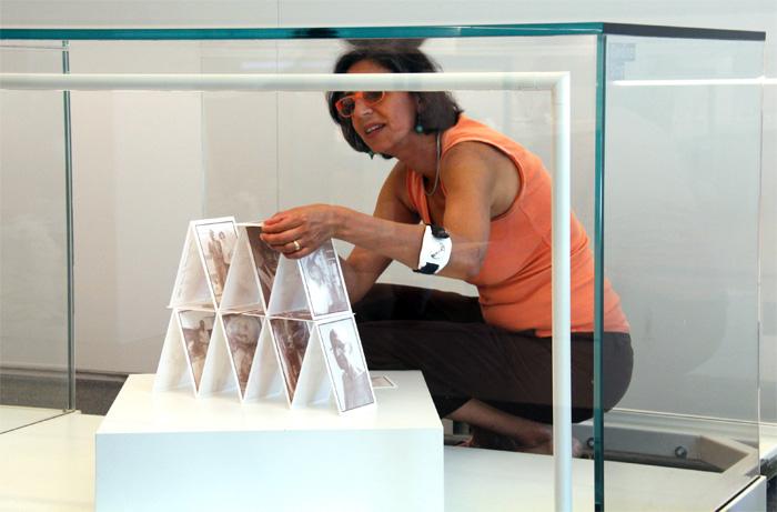 Artist Heidi McKenzie installing her exhibition Family Matters