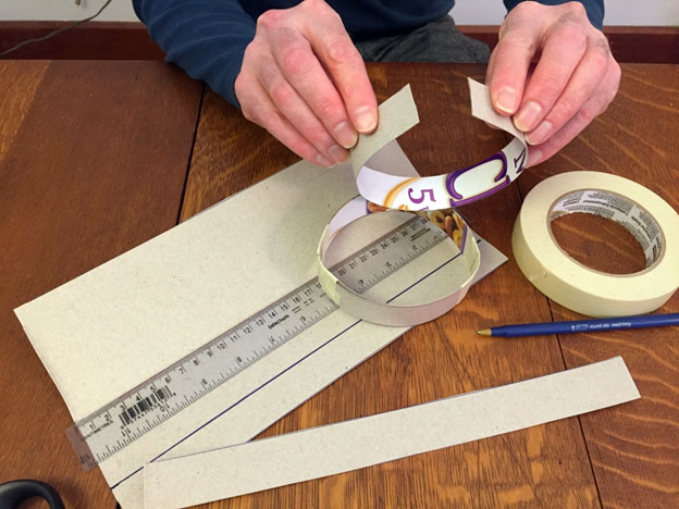 Hand shaping a cardboard ring