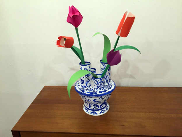 Homemade blue-and-white tulip holder with paper flowers