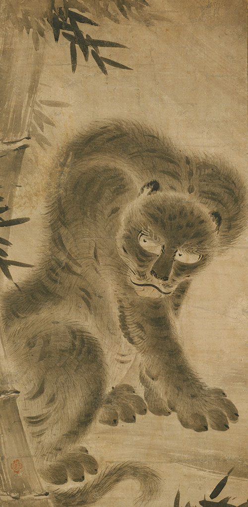 A scroll with a tiger and bamboo design