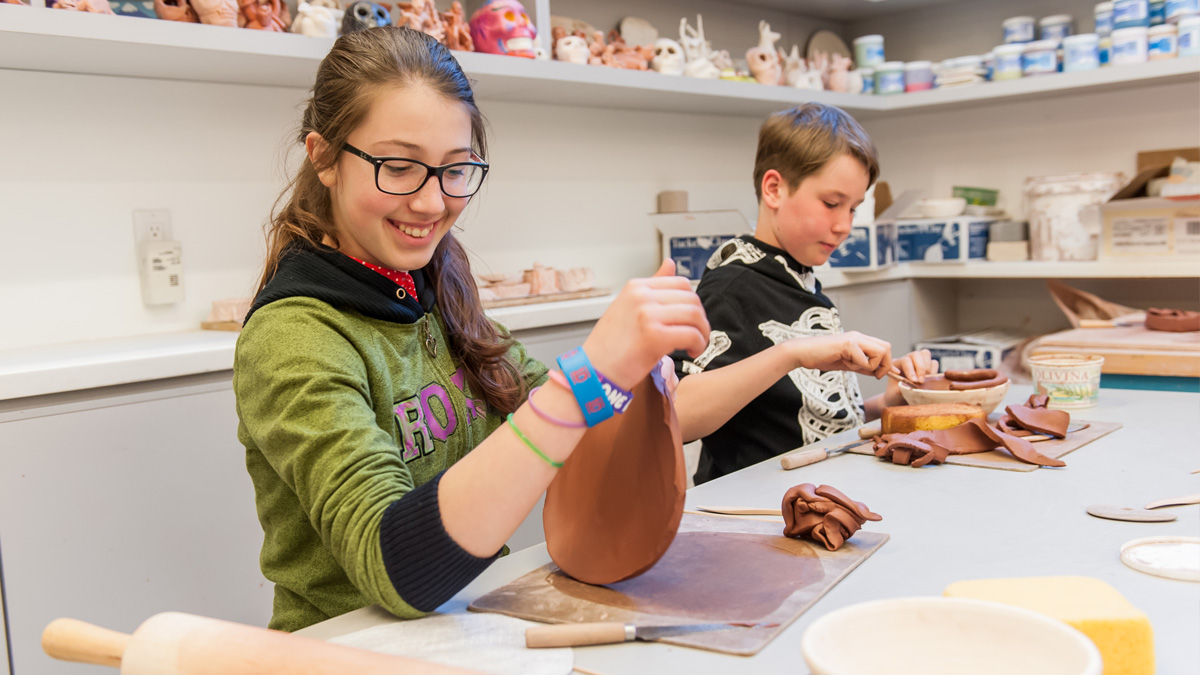 Two children creating with clay