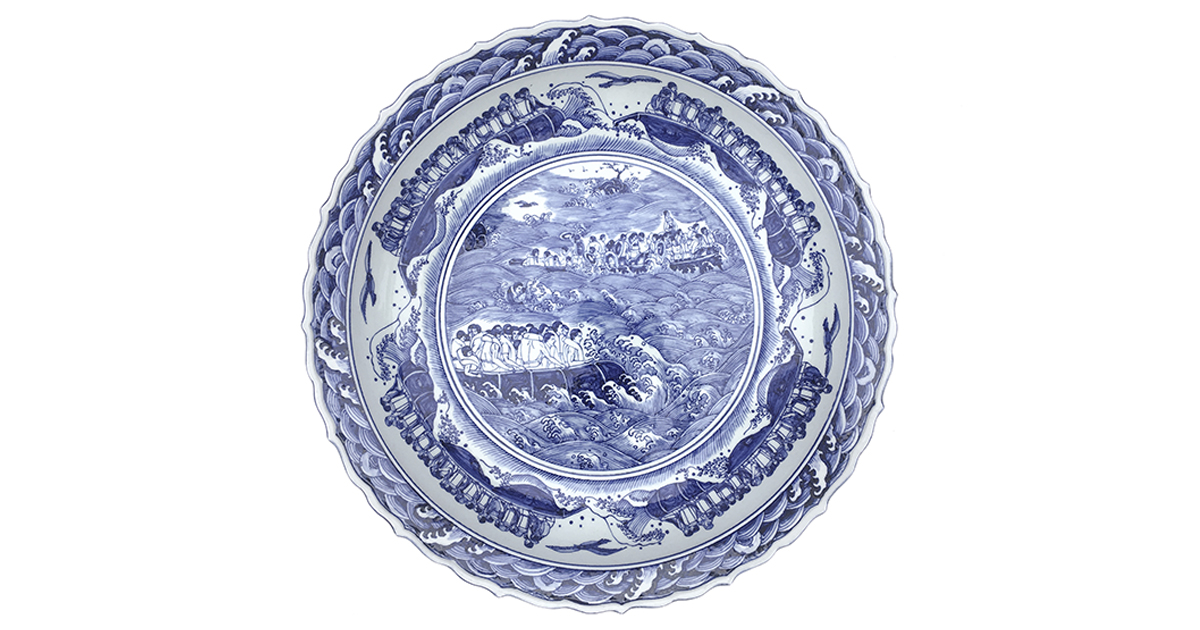 Blue and white porcelain plate by Ai Weiwei with images of refugees crossing the sea in boats