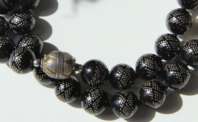 Close up of black coral beads