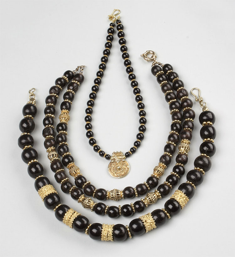 Necklaces made with black coral and antique coins