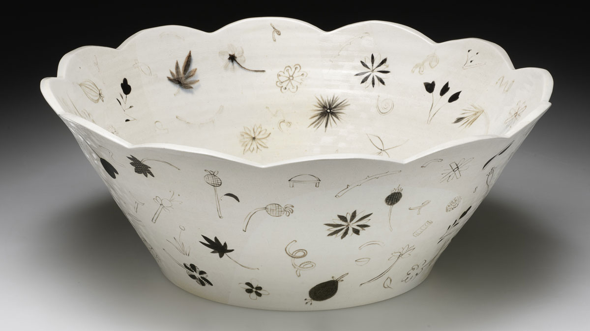 Ceramic bowl with scalloped edges
