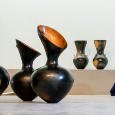 Artist Magdalene Odundo with her ceramic vessels