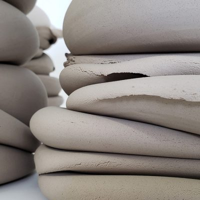Rounds of grey clay stacked. By Michelle Mendlowitz and Robin Tieu