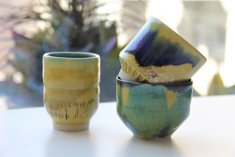 Three small tea bowls in blue and yellow