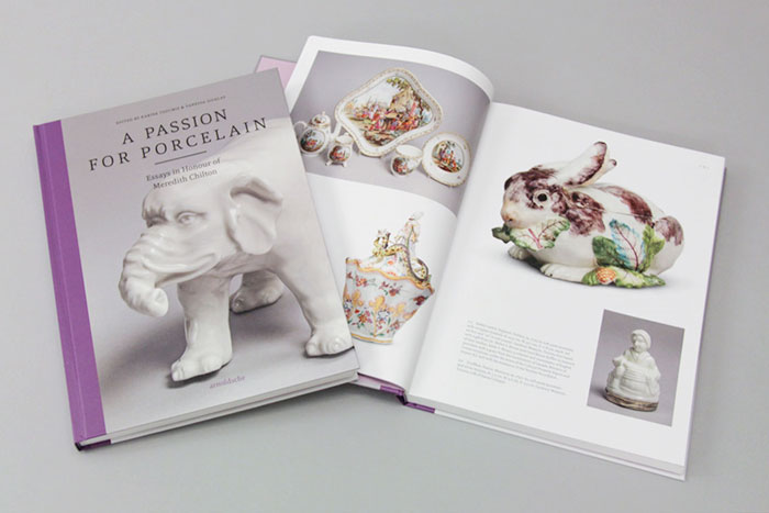 Book with a white ceramic elephant on the cover