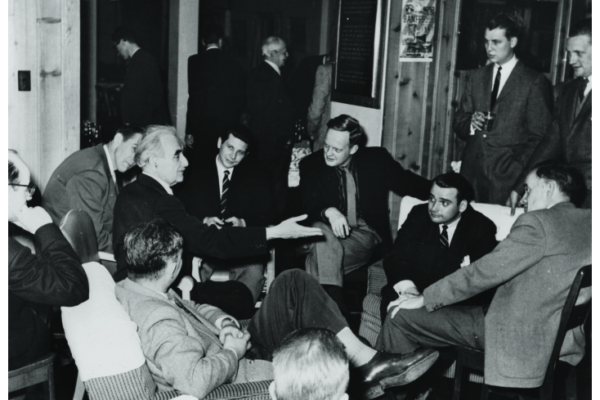 Richard Neutra (hand extended) in conversation after a lecture at the Vancouver Art Gallery, with Arthur Erickson (centre) and Ron Thom (centre right), 1949. Photographer unknown. Collection of the Thom family.