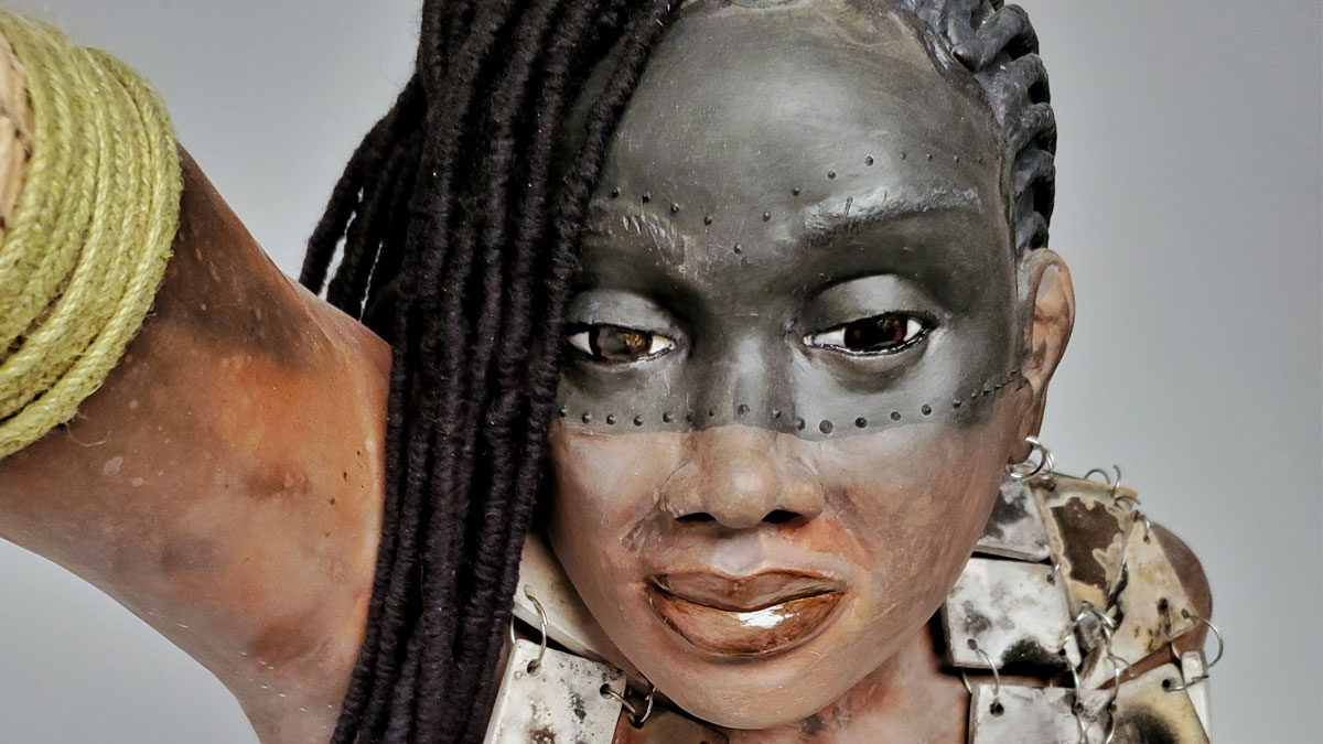 Ceramic bust of a warrior woman with braids