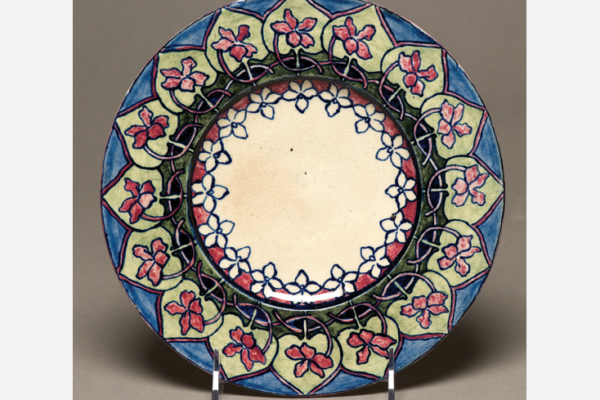 "Plate, c. 1896. Underglaze painting of Southern coast violet design. Margaret H. Shelby, decorator; Jules Gabry, potter. Diameter: 8"" Newcomb Art Collection, Tulane University, New Orleans, LA."