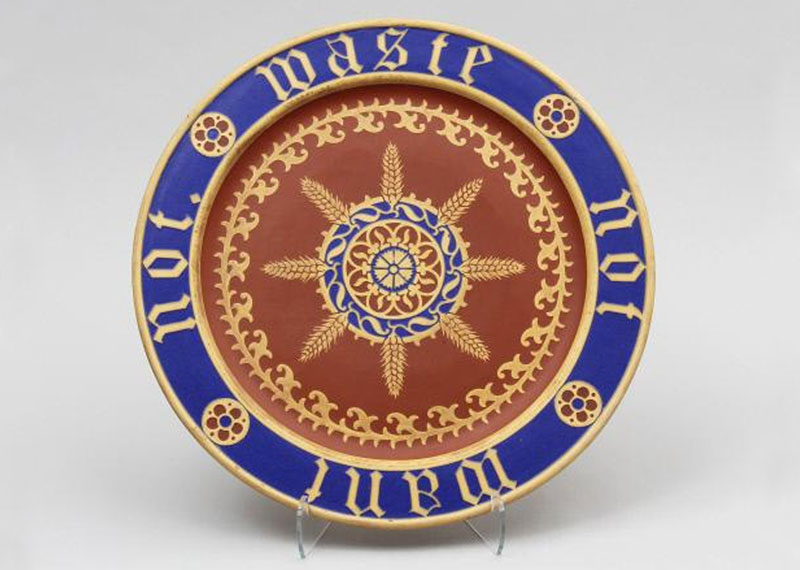 Blue and terracotta bread plate with an inscription