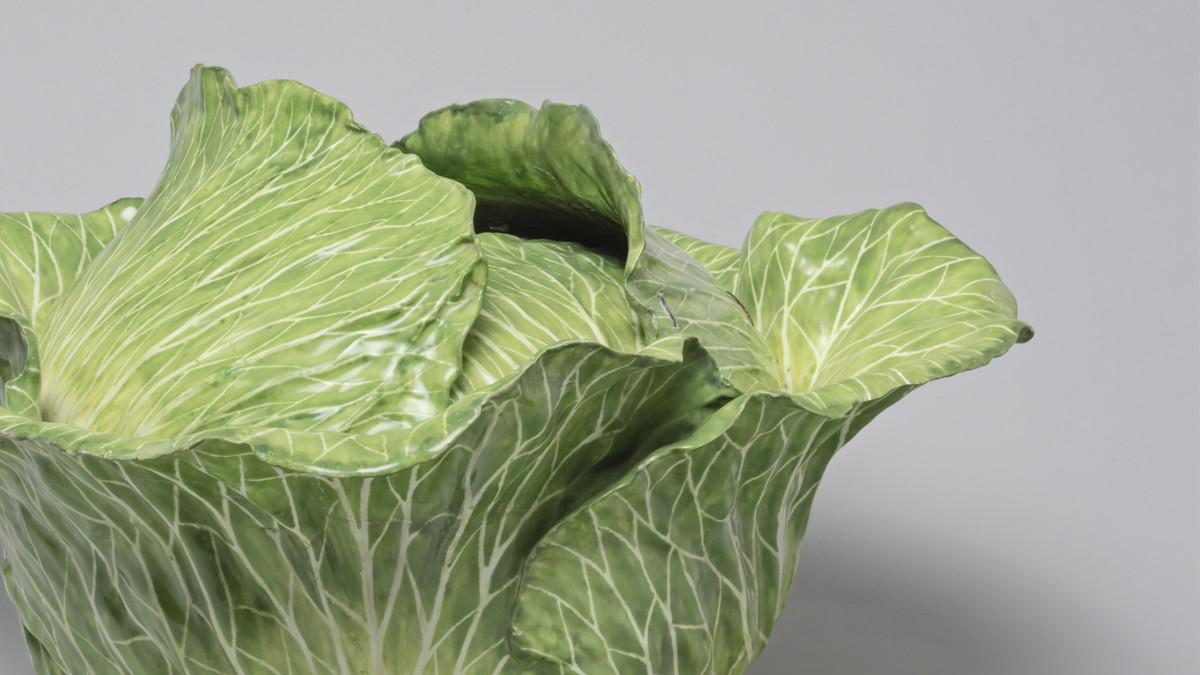 Close up image of a soup tureen in the shape of a cabbage