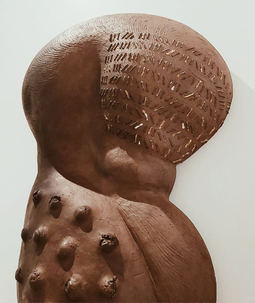 Abstract sculpture of a body with scarification