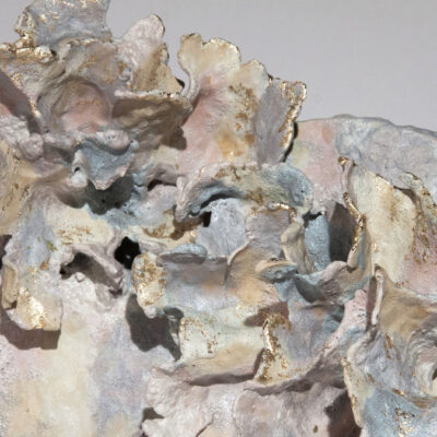 Detail of an abstract sculpture with pastel coloured glazes