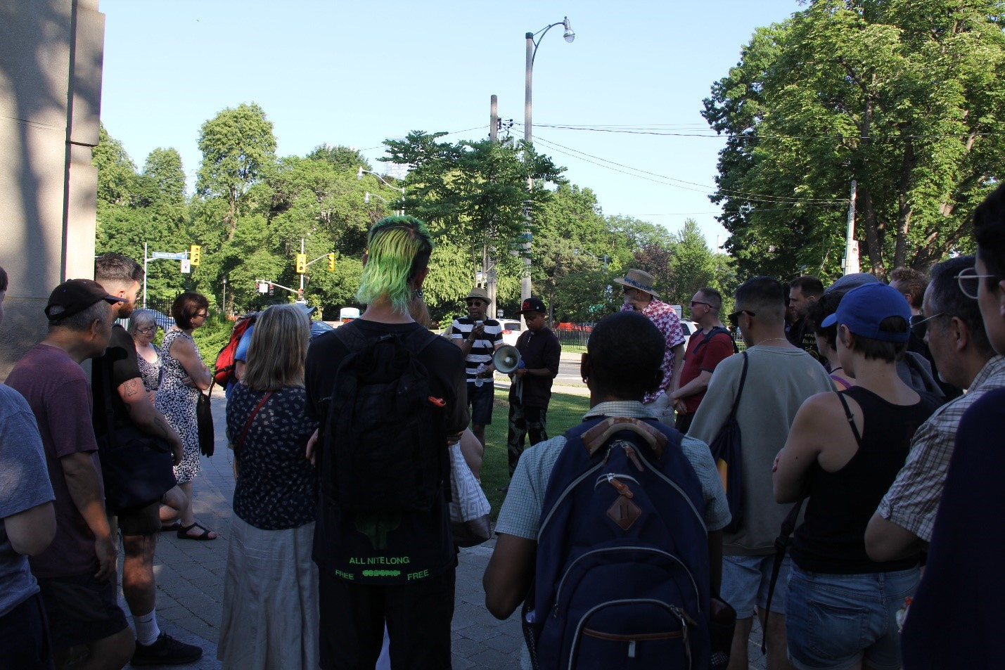 People participating in a walking tour of Queen's Park