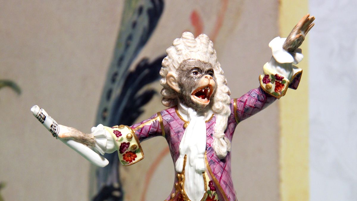 Meissen porcelain monkey dressed as a conductor with a white powered wig
