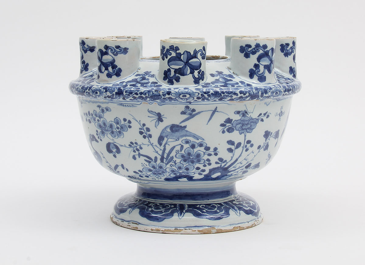 Blue and white ceramic bowl with multiple spouts