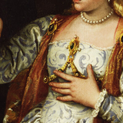 Detail of a painting with a Renaissance woman in an ornate dress with jewellery