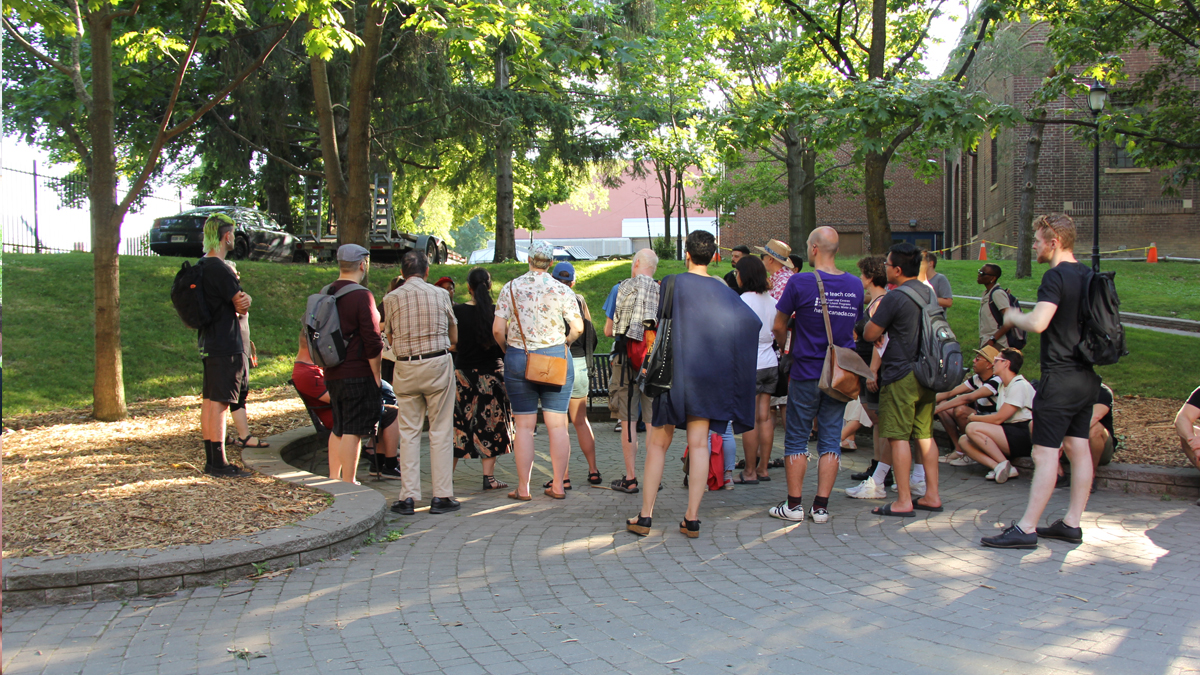 Participants taking part in a walking tour in Queen's Park