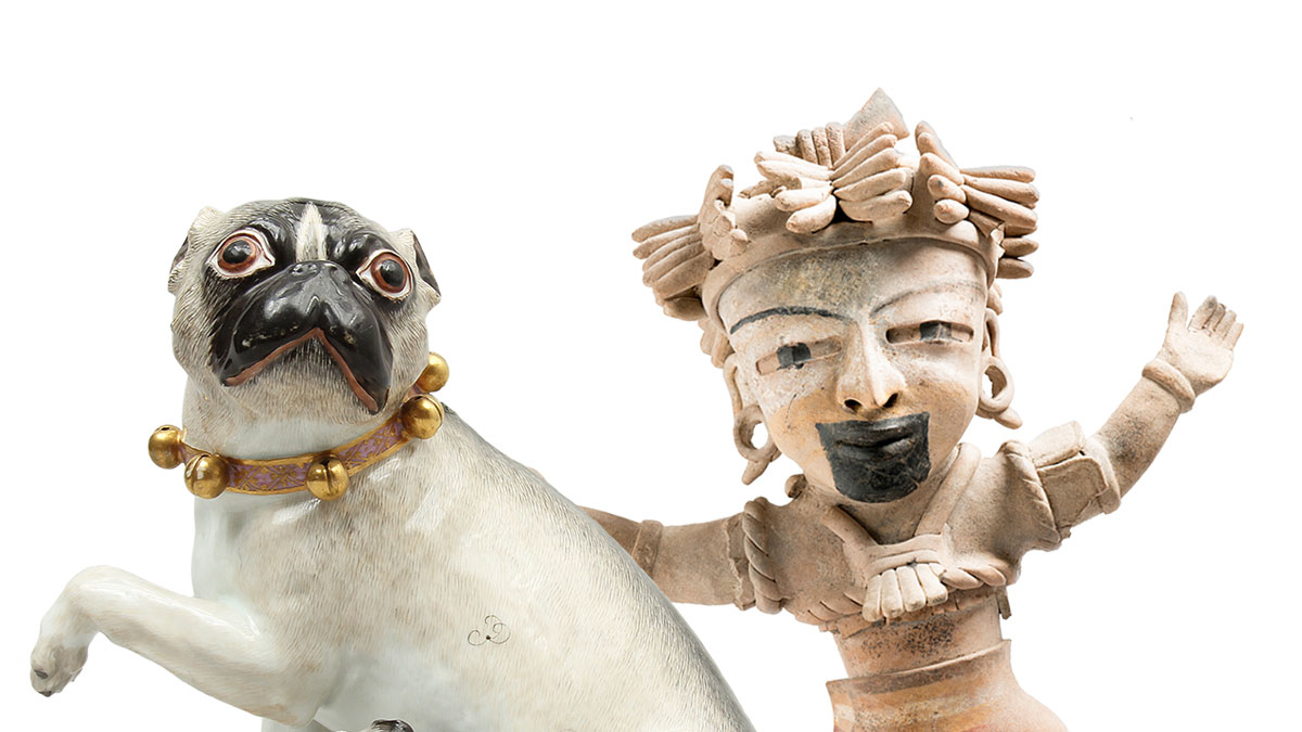 Porcelain pug and Ancient American figure with a headdress