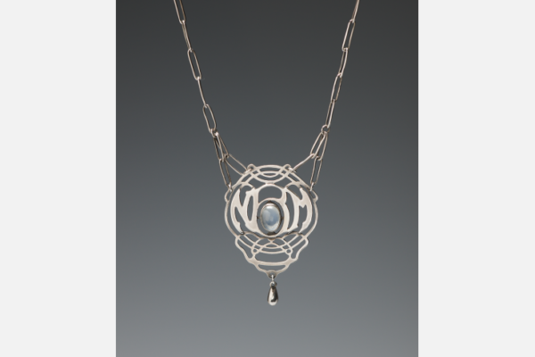 "Silver necklace with moonstone and pendant, c.1929. Hand-wrought chain with cut out ""NBM"" (Nellie Mae Bartlett) monogram. Newcomb Art Collection; gift of Nelle Mae ""Jack"" Bartlett Kelleher, Tulane University, New Orleans, LA."